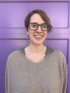 Gesshin in front of a purple wall