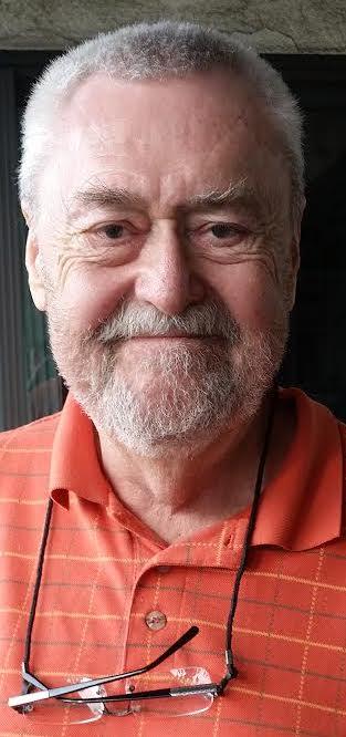 James Ford wearing an orange shirt